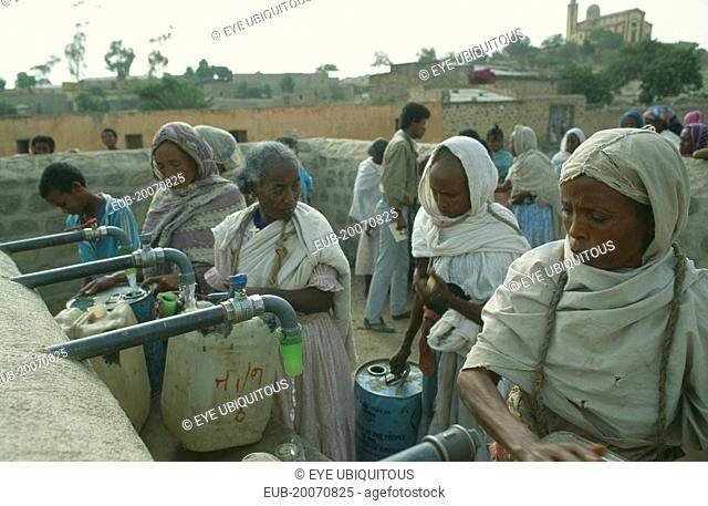 Women filling containers at water point