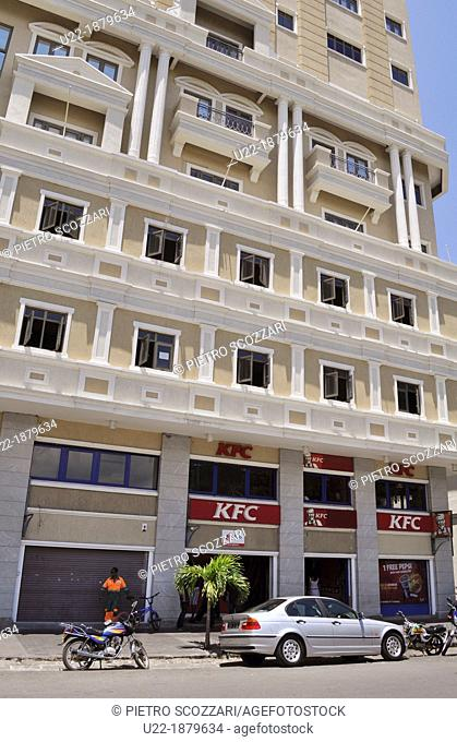 Mauritius, Port Louis, tall apartment building and KFC fast-food in the city center