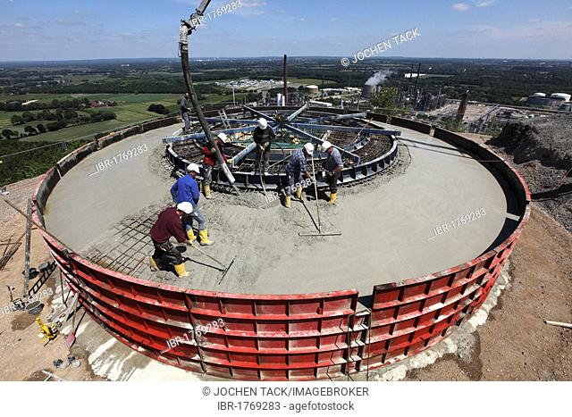 Concreting the foundations during the construction of a wind turbine on a mountain slope in Scholven, Gelsenkirchen, North Rhine-Westphalia, Germany, Europe