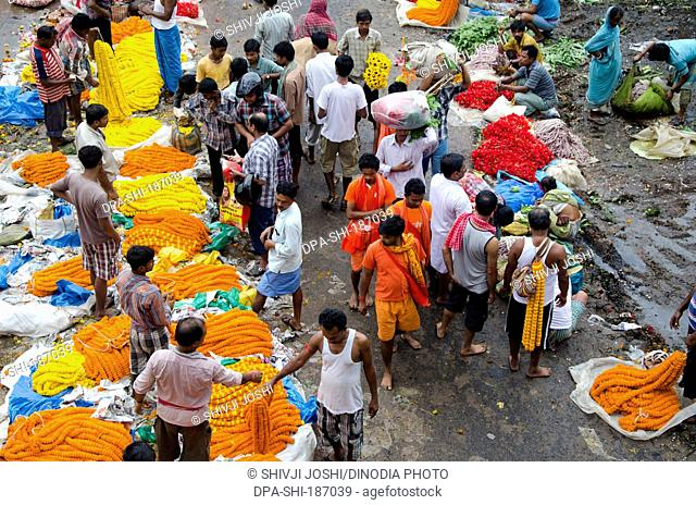 People buying flowers in market Kolkata at West Bengal India Asia