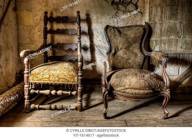 Two broken armchairs