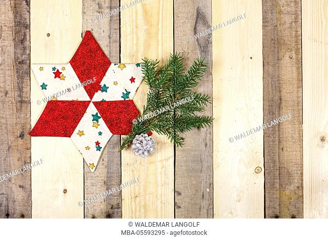 Christmas decoration, star made of fabric, twig