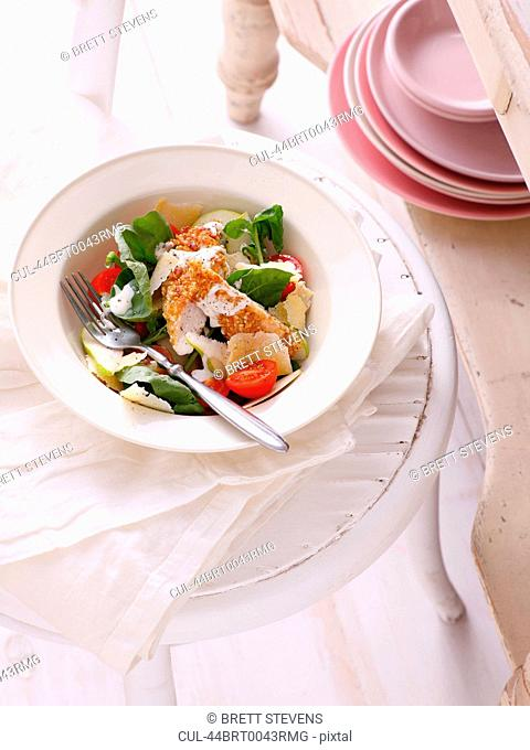 Bowl of salad on table