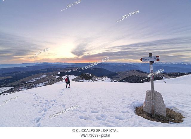 Hiker on Cima Grappa, Grappa Mount, Prealps of Belluno, Crespano del Grappa, Vicenza province, Veneto, Italy