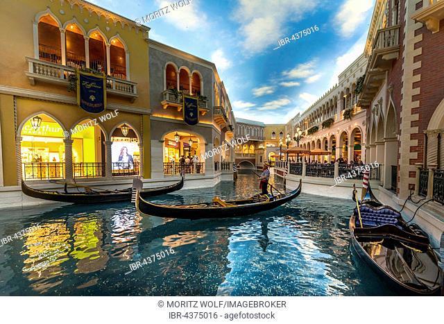 Replica of Venice, Venetian gondolas on canal, artificial sky, The Venetian Resort Hotel Casino, Las Vegas, Nevada, USA