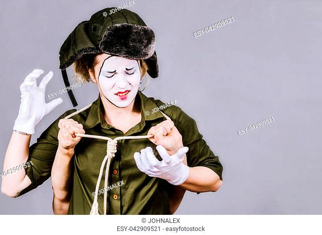 woman mime posing with a loop in photo studio