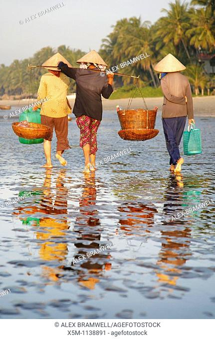 Three women on Mui Ne beach