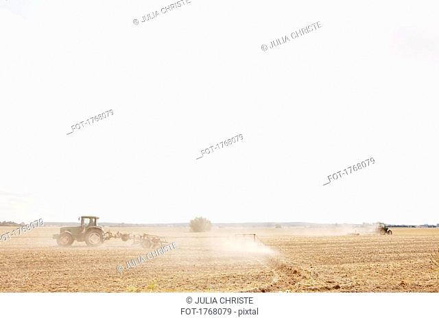 Tractor plowing sunny, agricultural field, Wiendorf, Mecklenburg-Vorpommern, Germany