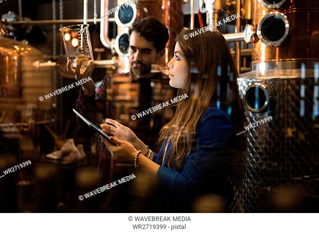 Man and woman working in beer factory