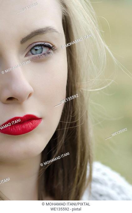 Beautiful young woman staring