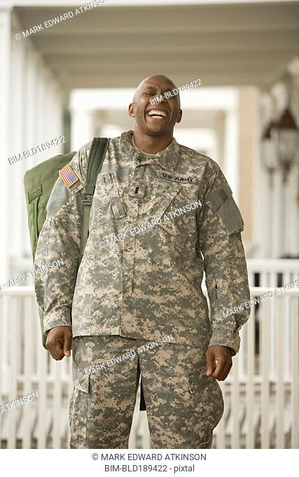 African man in military uniform laughing