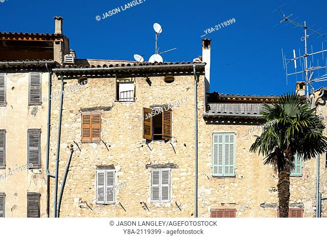 Shutters and windows on old houses in Seillans, Var Department, Provence-Alpes-Côte d'Azur, France