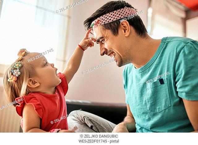Father and little girl having fun together at home