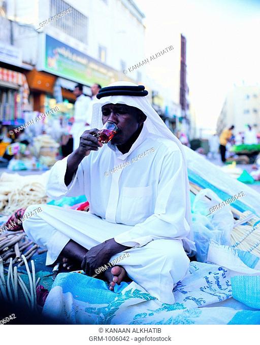 Merchant drinking tea in Bab Makkah, Jeddah, Saudi Arabia