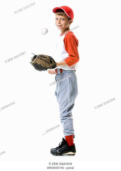 Portrait of a baseball player tossing a baseball