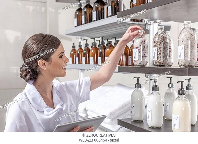 Shop assistant in wellness shop checking the stock