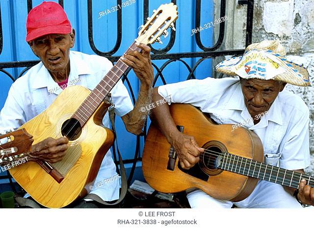 Musicians playing guitars, Havana Viejo, Havana, Cuba, West Indies, Central America