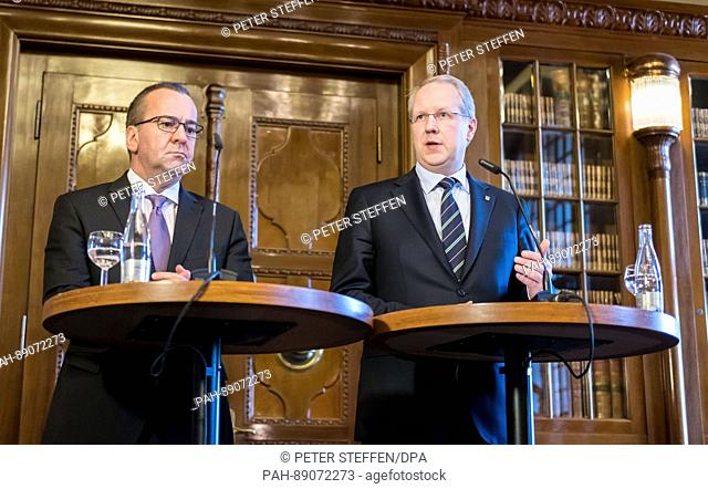 Interior Minister Boris Pistorius (both SPD, l) and Hanover's Lord Mayor Stefan Schostok speaking in the city hall in Hanover, Germany, 16 March 2017