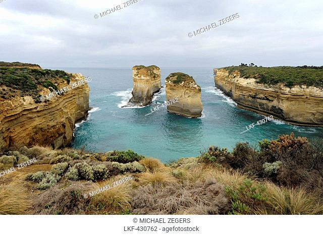 Erosion of rocky coast along the Great Ocean Road at Loch Ard Gorge, Port Campbell National Park, Victoria, VIC, Australia