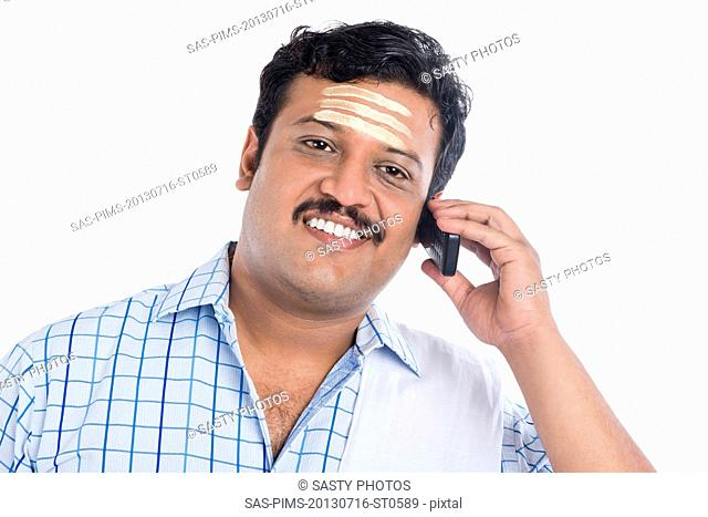 South Indian man talking on a mobile phone