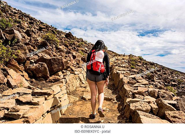 Hiker on hiking trail, Haleakala National Park, Maui, Hawaii