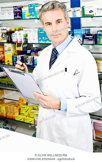 Portrait of a pharmacist holding a clipboard