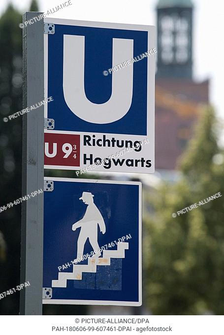 """6 June 2018, Darmstadt, Germany: A metro sign indicates a U9 3/4 transfer towards the magical school Hogwarts from the book series """"""""Harry Potter"""""""""""