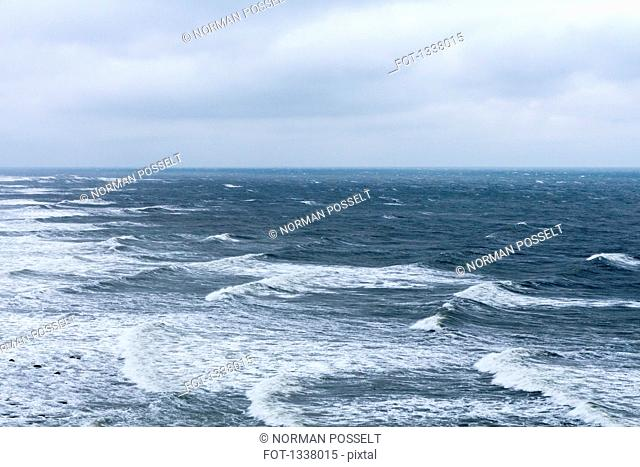 Waves on Baltic Sea against cloudy sky, Cape Arkona, Germany