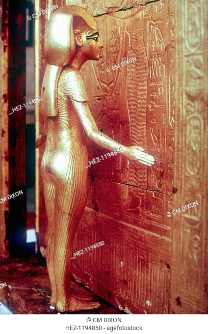 Isis the protective goddess guarding the Canopic Shrine, Tomb of Tutankhamun, Cairo, The Egyptian Museum. Tutankhamun reigned between 1336 BC and 1327 BC
