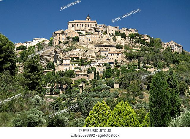 Gordes. View of hilltop village from the road below with church at summit
