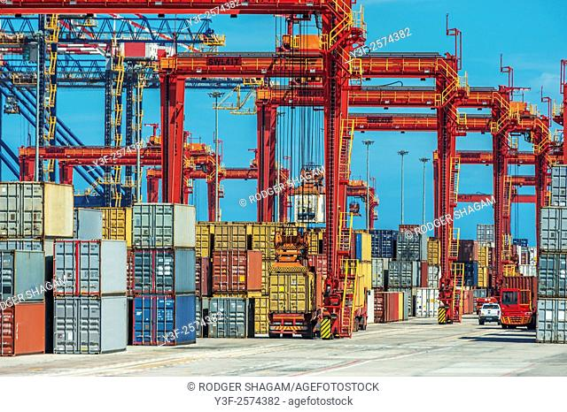 Container depot at the Cape Town docks. South Africa. Huge container lifters are constantly on the move