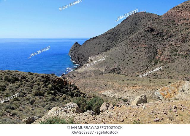 Coastal landscape Cabo de Gata national park, looking west to Vela Blanca tower, Almeria, Spain