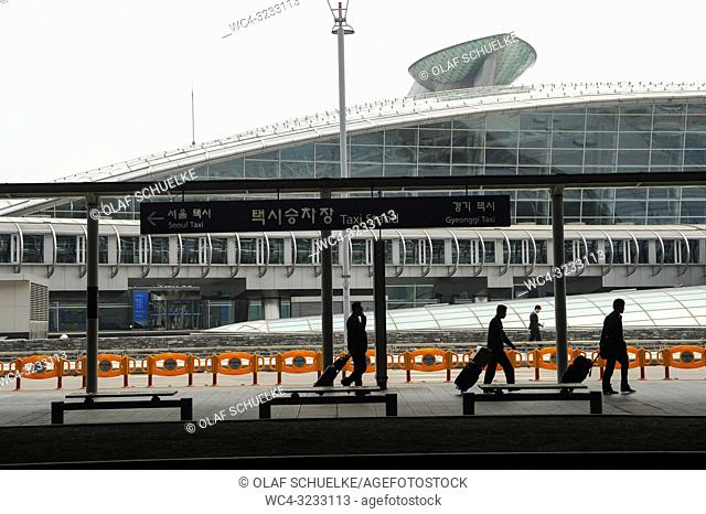 Seoul, South Korea, Asia - Travelers at Incheon International Airport with the train terminal in the backdrop