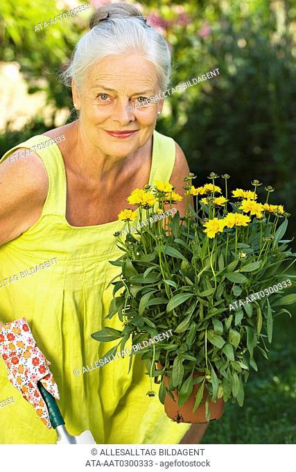 Elderly lady in the garden