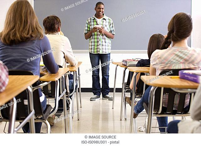 Male high school student giving presentation