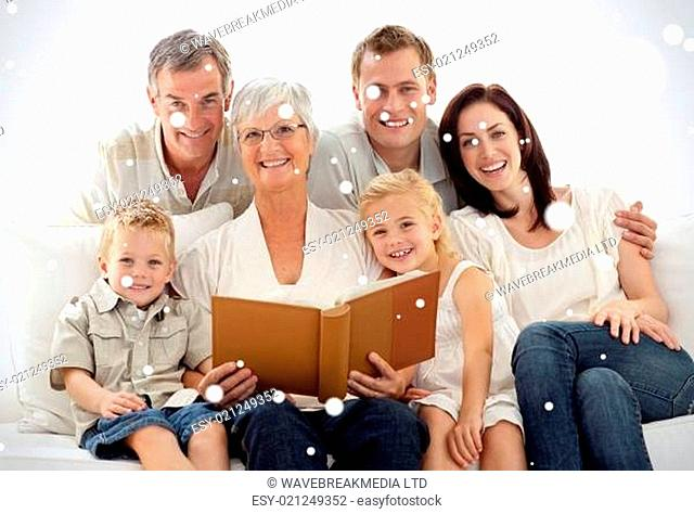 Composite image of grandmother reading a book to her children and parents