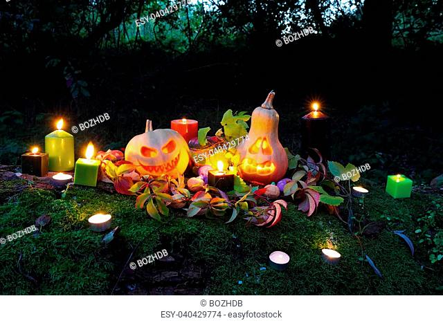 Halloween pumpkin lanterns with autumn leaves and candies