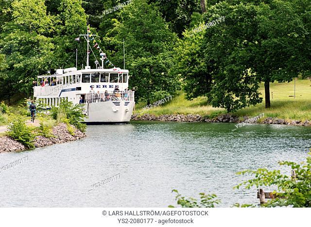 Tranquil summer landscape. Passenger ship on Gota Canal in Sweden
