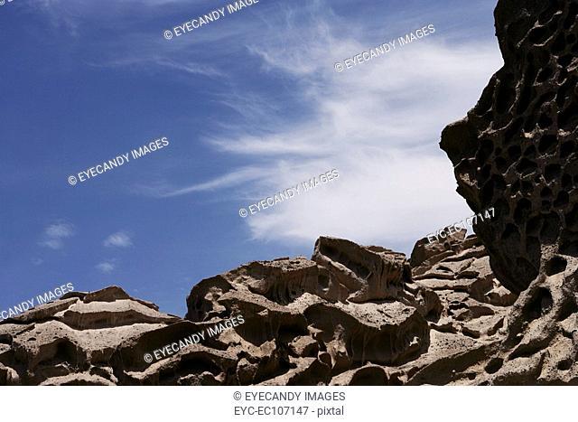 Rocky mountain against blue sky