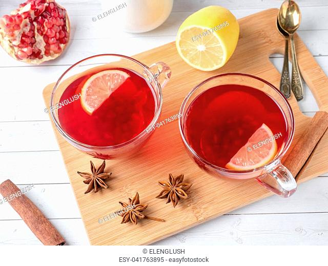 Hot homemade lemonade with pomegranate, lemon and winter spices