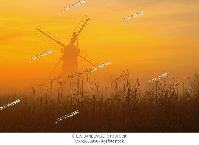 St Benets Level Drainage Mill in winter sunset Norfolk Broads