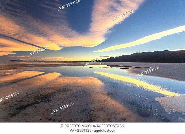 Sunset at Salar de Uyuni the world's largest salt flat located in Bolivia,at an elevation of 3656 meters above sea level