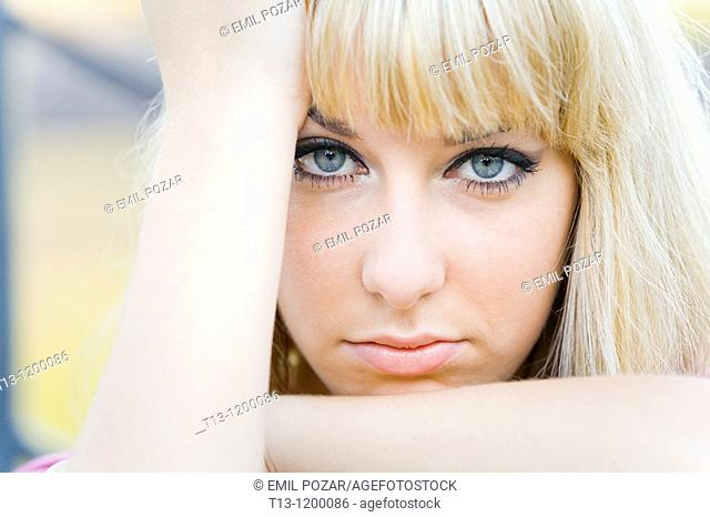 Worried young woman portrait framed with her hands