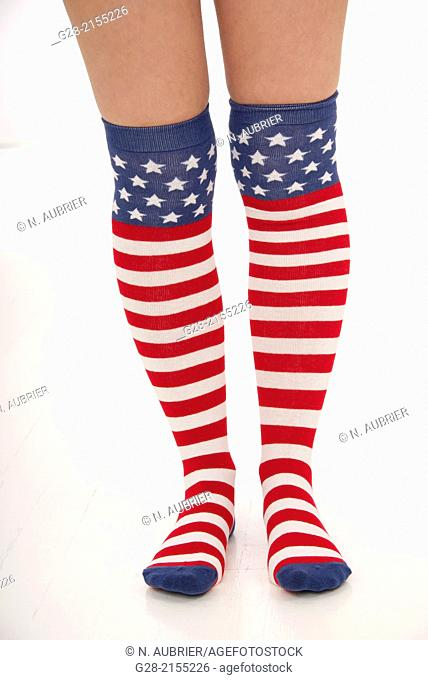 2 young woman's legs in stars and stripes knee high socks