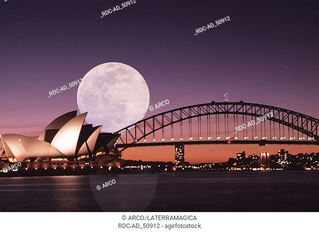 Sydney Bay with Sydney Opera House Harbour Bridge and full moon Sydney New South Wales Australia