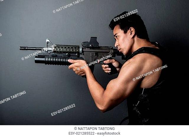 soldier man hold Machine gun