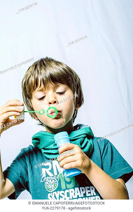 Portrait of child and soap bubbles
