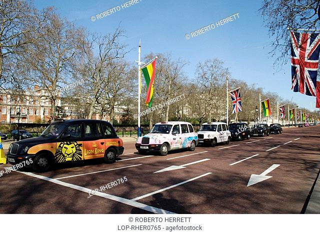 England, London, Westminster, Taxi cabs at the Mall lined with Union Jack and European Union flags