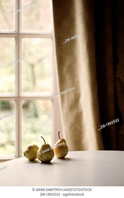 Still life of three pairs by the window