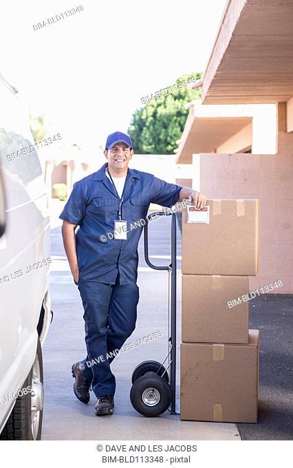 Hispanic deliveryman with packages